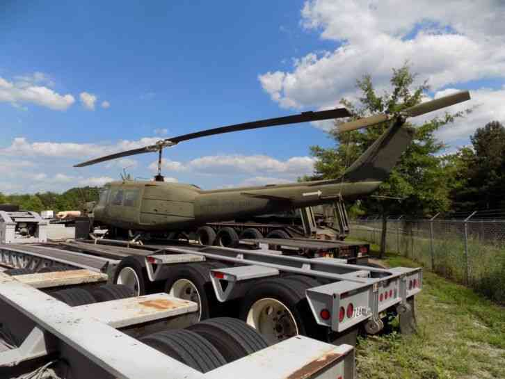 huey helicopter for sale price with 010833 on Hughes Helicopters Ah 64 Apache further P2786335 13914201 also Yater Charlie Dont Surf T Shirt Army Green as well Russian Mi 35 Attack Helicopter Flying as well Viewonekit.